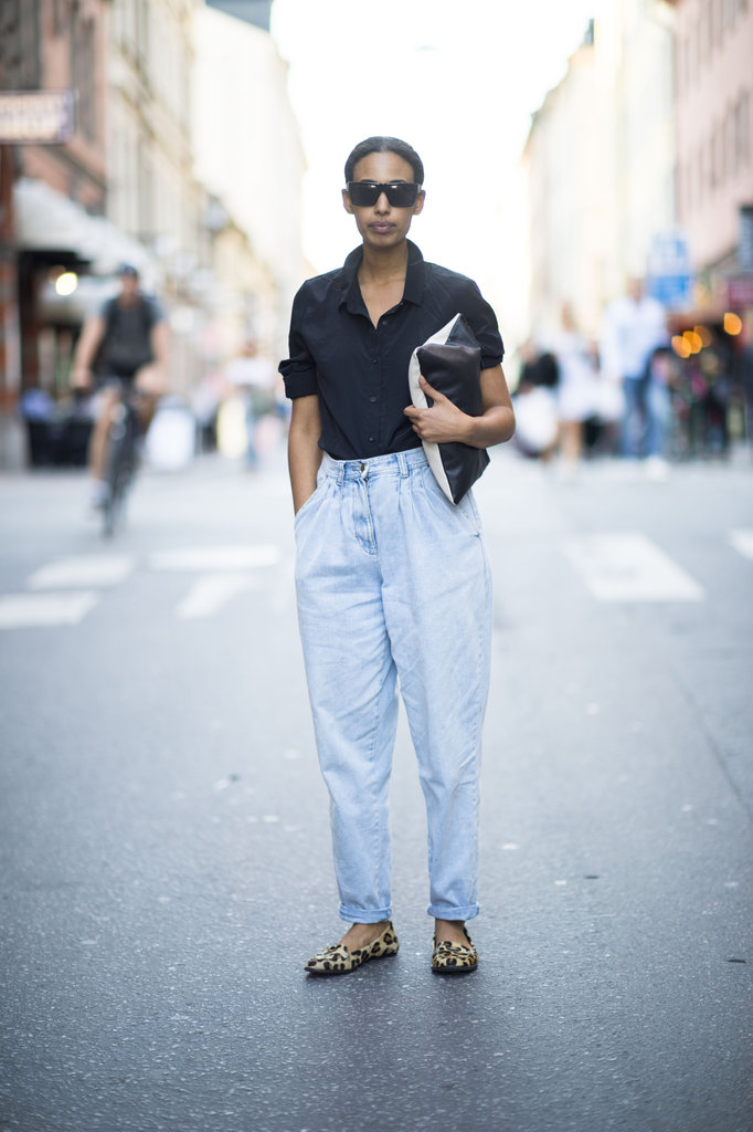 Temper pleated denim with a slim-fit button-down and chic add-ons like an oversize clutch and leopard-print loafers. Source: Adam Katz Sinding