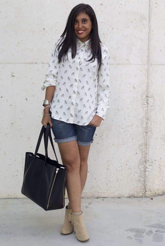 Work denim shorts into your Fall look with a pair of suede ankle boots and a printed button-down.
