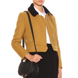This Carven Wool Cashmere Jacket ($844) is equal parts ladylike and boyish thanks to the tailored fit, cute Peter Pan collar, and zipper details. I love the idea of pairing this stunning piece with moody print dresses and culottes for a whimsical take on Fall. — Chi Diem Chau, associate editor