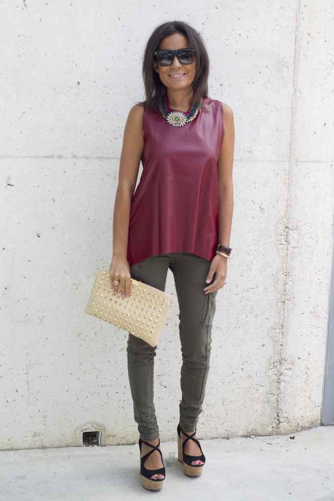 Give your everyday look a Fall update with rich hues on your tops and bottoms. We love this burgundy and olive mix-up, especially with her leather top.