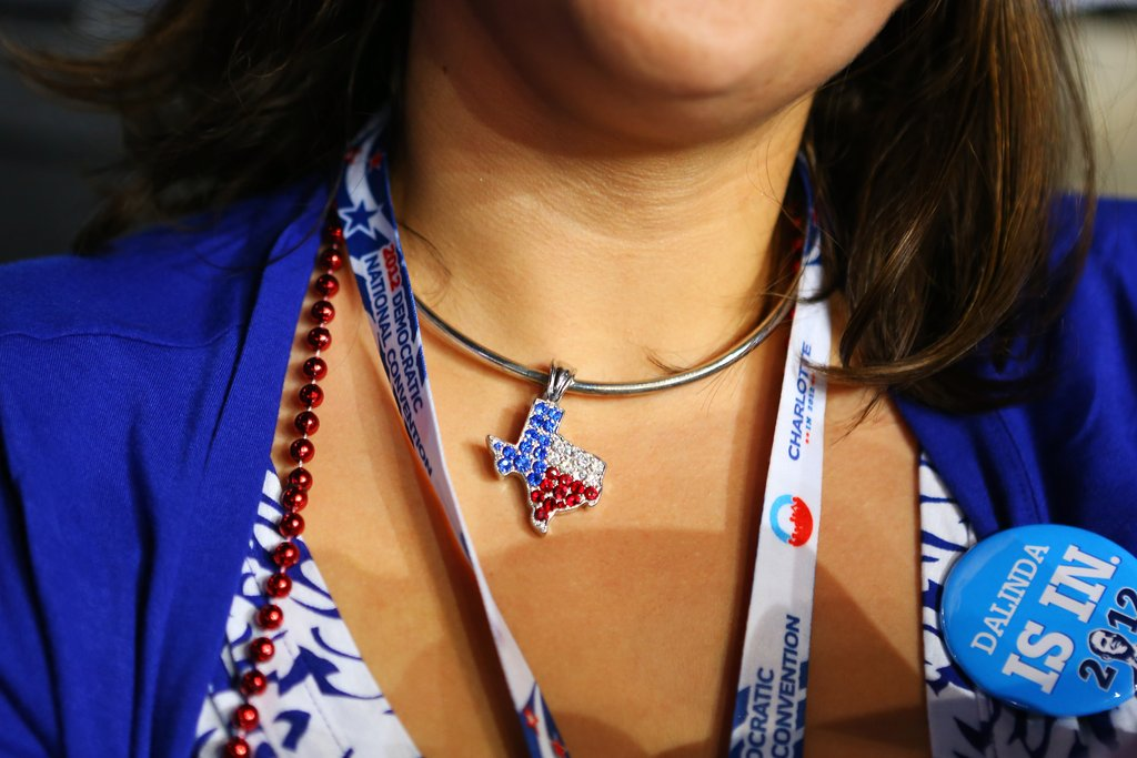 This lady wore a necklace to show her state pride.