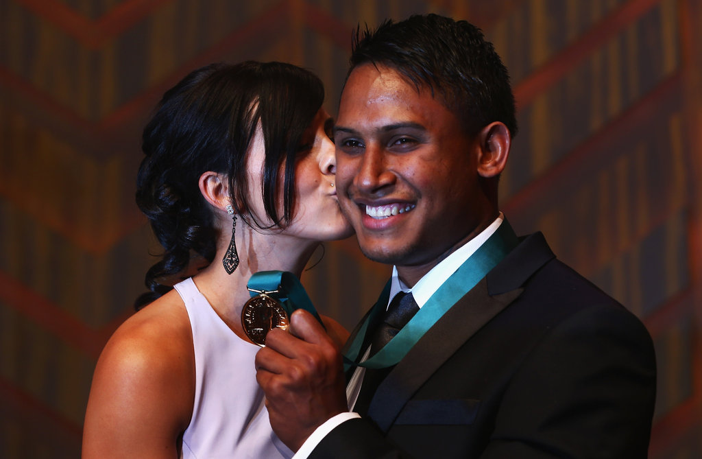 Ainslie Curry gives Ben Barba a congratulatory kiss as he holds upo his Dally M Medal.