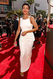 Rihanna strut down the carpet in a white gown.