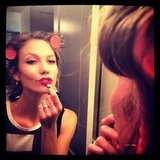 Karlie Kloss applied some makeup before her big FNO appearance. Source: Instagram user karliekloss