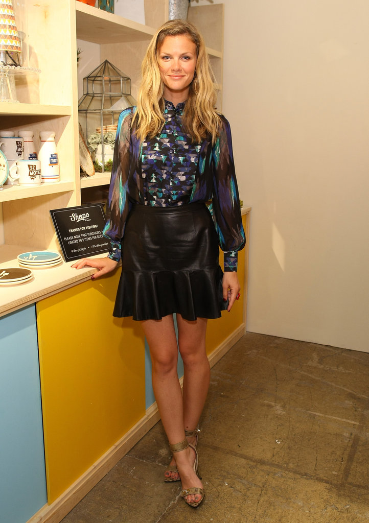Brooklyn Decker topped a leather skirt with a sheer, printed blouse at the Shops at Target launch.