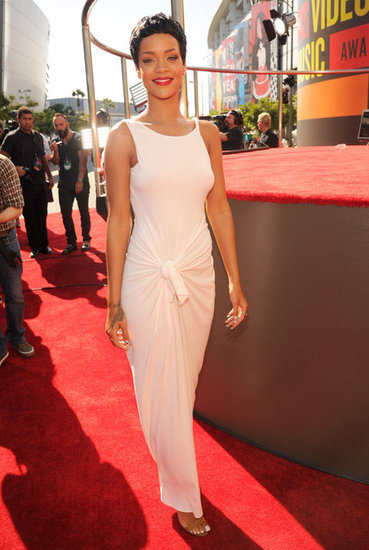 Rihanna looked stunning in a clean white Adam Selman gown, accented with a pixie cut and a red lip.