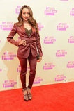 Kat Graham went with a sharp satin pantsuit and heels.