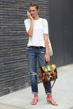 Sometimes, it's all about the accessories — with this white tee and distressed denim look, it's really all about the printed Proenza satchel and strappy sandals.