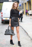 All-black everything — a pared-down take on the leather skirt that we're totally loving.