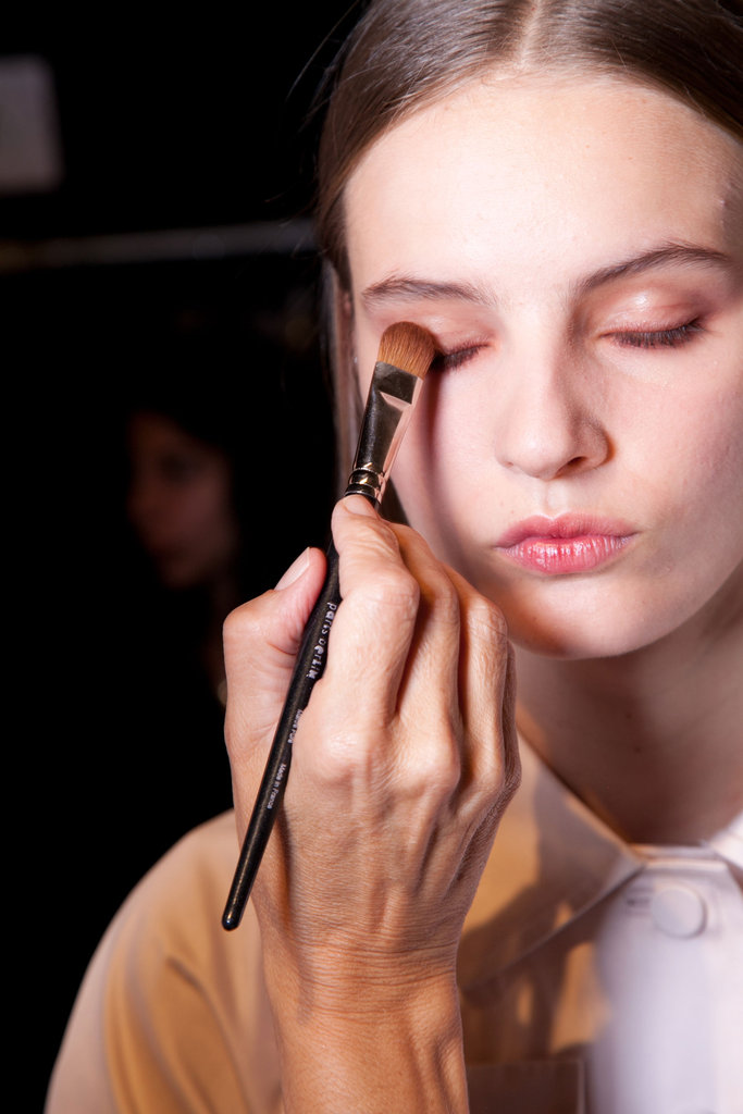 Kendal lined eyes with Jill Stuart Cosmetics eye pencil in Deep Brown, then applied Anastasia brow powder to brows.