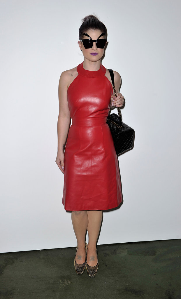Kelly Osbourne brought the fun factor in a red leather dress and eyebrow sunglasses at House of Holland.