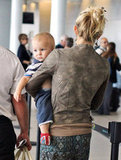 Kate Hudson carried Bingham through the airport.