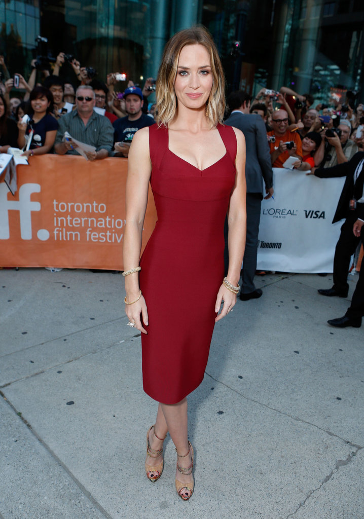 Emily Blunt showed off her figure in a formfitting Roland Mouret dress at the Looper premiere.