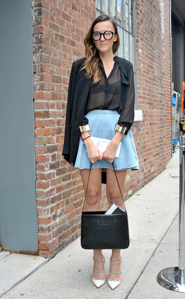 The effect of a sheer top against a denim mini is infinitely more chic with a Céline bag and Valentino heels.