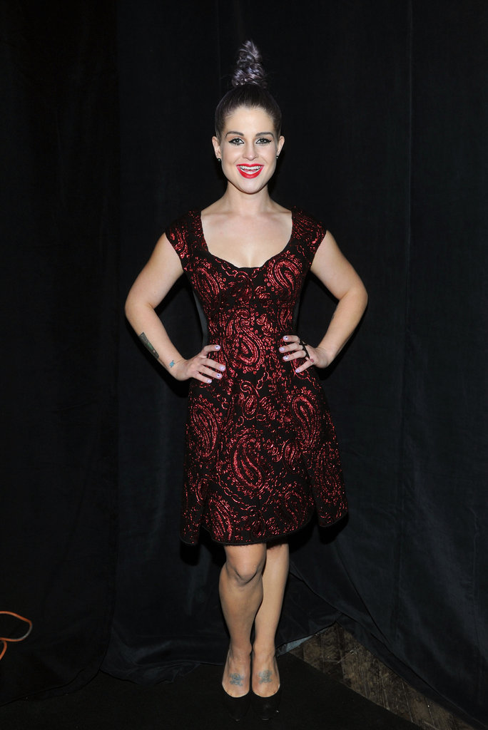 Kelly Osbourne chose one of the designer's Fall '12 dresses — in that recognizable rose brocade — for the Spring show.