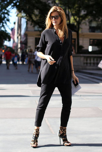 A simple tunic and skinny pants get an edgy counterpart in a pair of strappy leopard-print heels.
