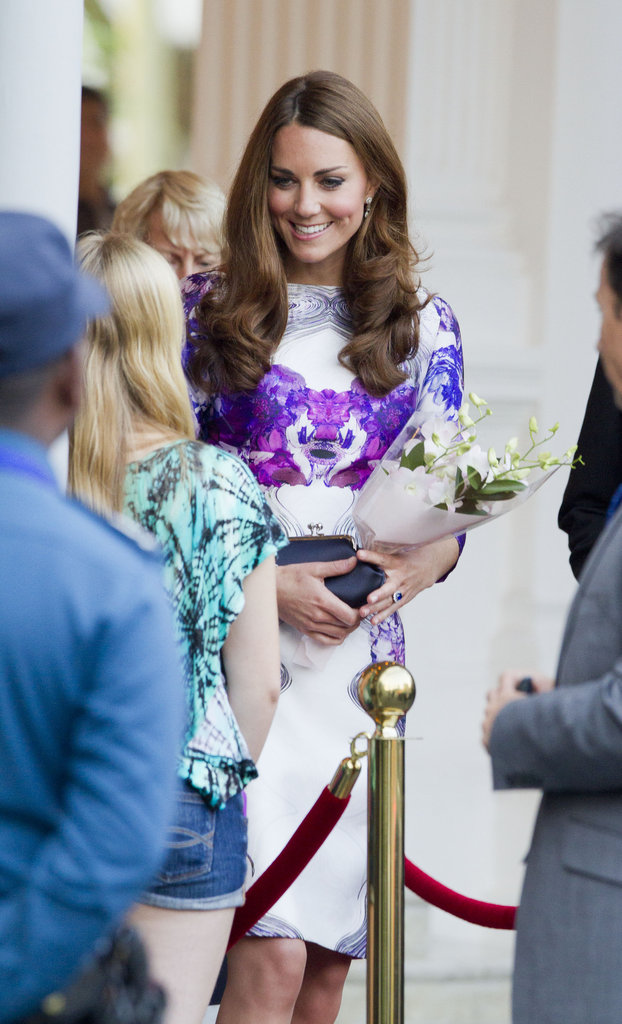 On Tuesday Sept. 11, Kate wore a white and lilac floral dress by Singaporean-born designer Prabal Gurung for the welcoming ceremony at the Istana Presidential Palace.