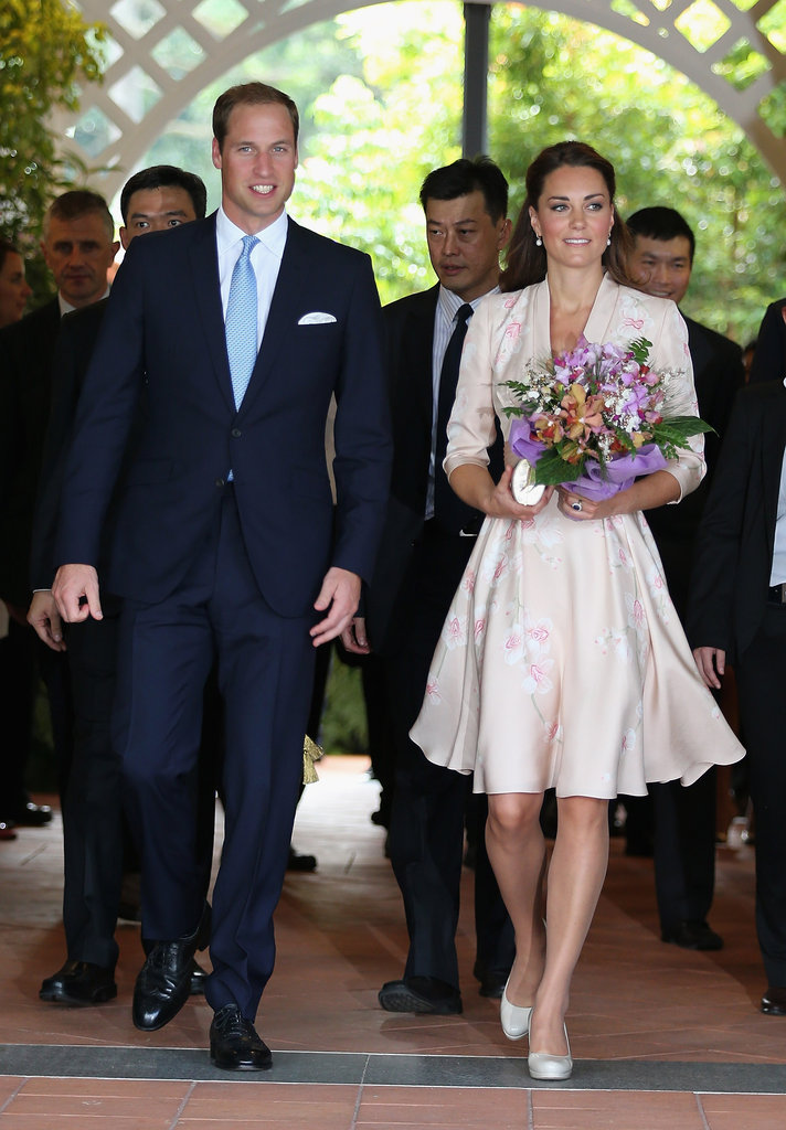 On arrival in Singapore on Tuesday Sept. 11, Kate wore a specially commissioned dress by British designer Jenny Packham.