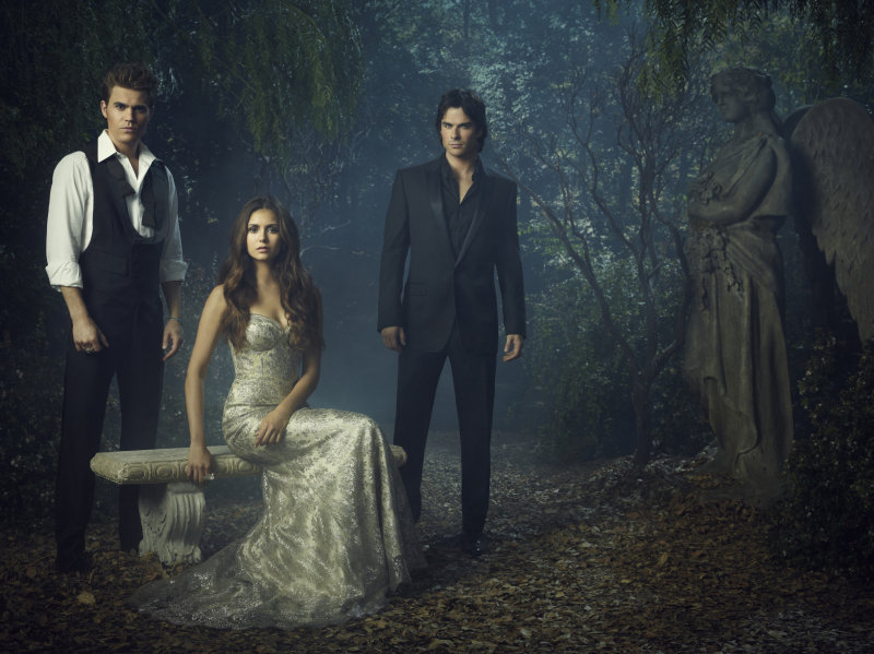 Paul Wesley as Stefan, Nina Dobrev as Elena, and Ian Somerhalder as Damon on season four of The Vampire Diaries.
