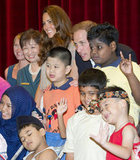 Will and Kate posed with a group of adorable children as they visited the Rainbow Centre on day two of the Diamond Jubilee tour of the Far East.