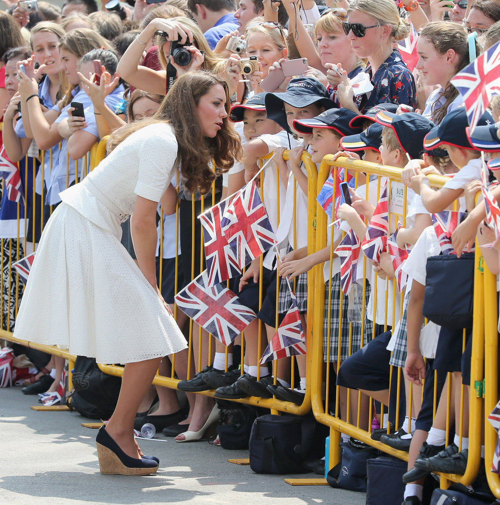Kate Middleton bent down to greet some younger fans in Singapore.