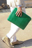 The envelope clutch in a pop of kelly green — crisp and cool against white pants.
