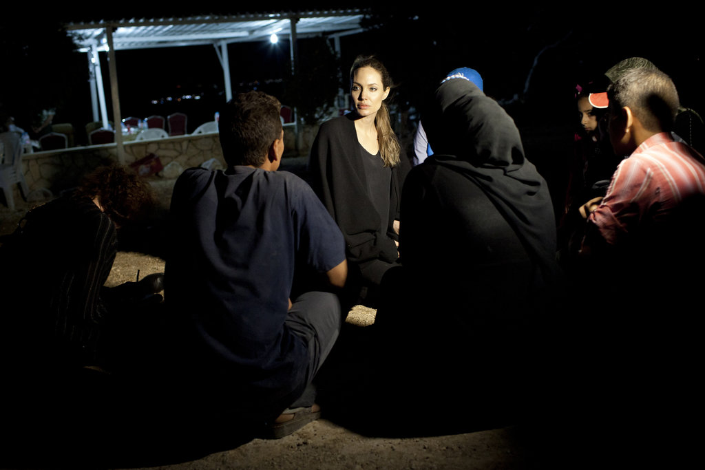 Angelina with Syrina refugees.