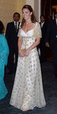 Kate Middleton entered the room wearing an Alexander McQueen gown.