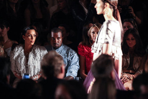 Kim Kardashian and Kanye West kept their eyes glued on the models.