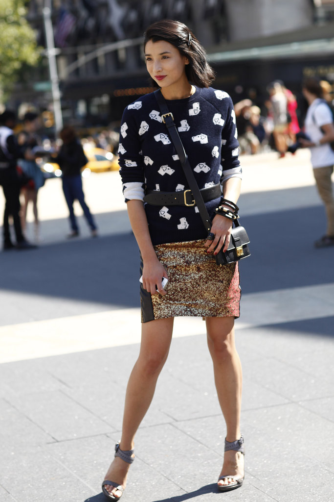 A cheeky sweater met a glittered skirt for a striking Fashion Week combo.