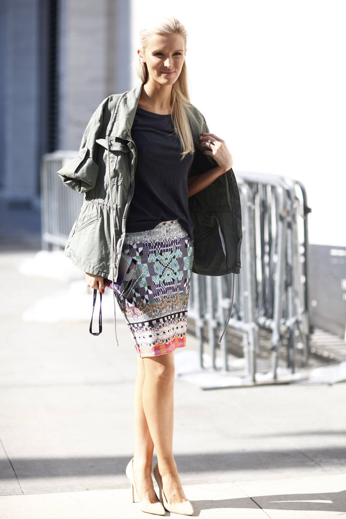 Rework a statement skirt with a slouchy t-shirt and a military jacket.