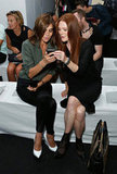 Carine Roitfeld and Julianne Moore shared a moment (and an iPhone) preshow at Reed Krakoff at New York Fashion Week. Note Carine's amazing white Cèline pumps.