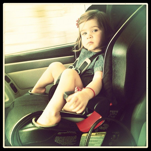 Tiffani Thiessen caught lil Harper's unique use for her car seat cup holders. Source: Instagram user tathiessen