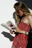 A pretty model read Sophie Kinsella's Shopaholic & Sister in the sun during Melbourne's Fashion Week in 2006.