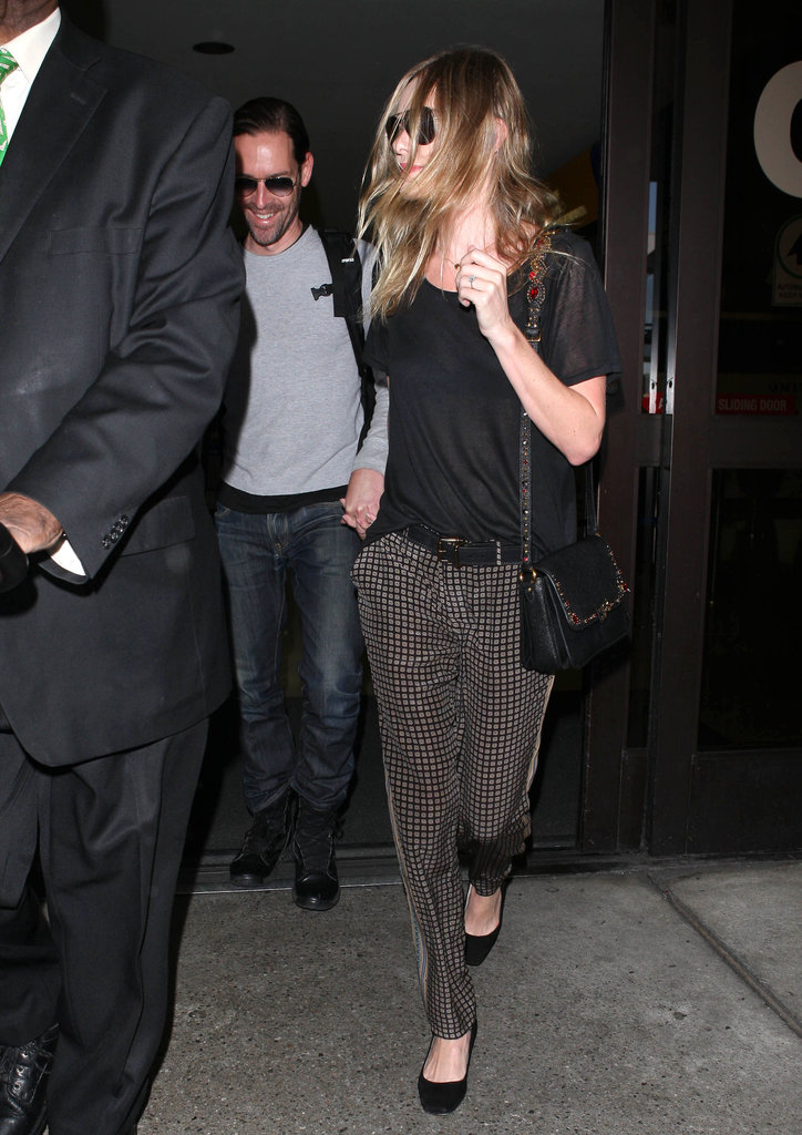 Kate Bosworth and Michael Polish held hands as they left LAX.
