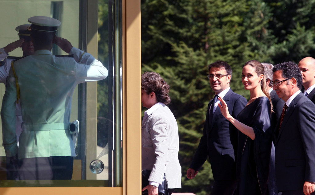 Angelina Jolie waved as she entered the building.