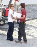 Josh Hutcherson chatted with a crew member on Catching Fire.