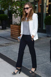 Elizabeth Olsen stayed impossibly chic in a white blazer and black pants — proof that easy does it.