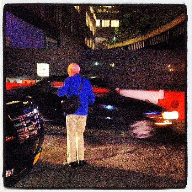 We spied Bill Cunningham in his signature blue coat on his way to Milk Studios during New York Fashion Week.