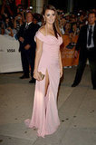 Penelope Cruz turned heads in a petal-pink vintage Versace gown at the premiere of Twice Born at the Toronto Film Festival.