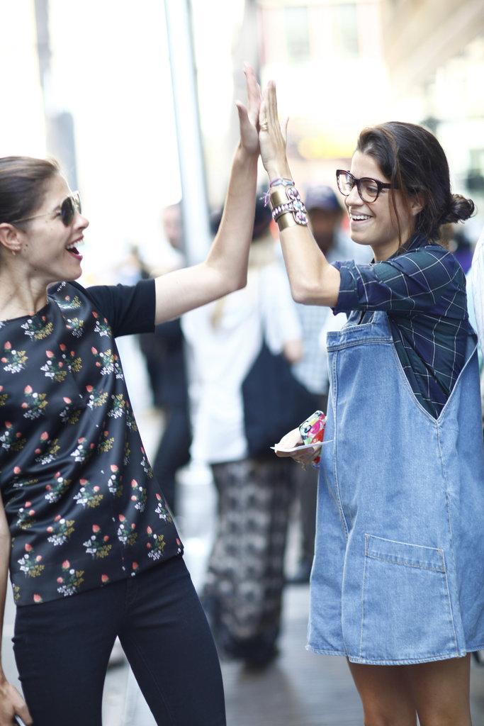 We agree — Leandra Medine's adorable overalls deserve a high-five. Source: Greg Kessler