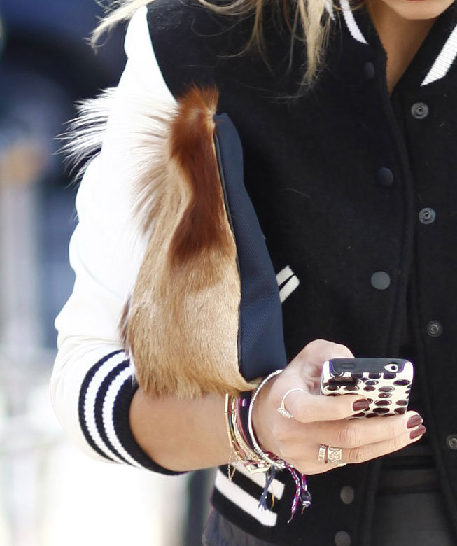 The fur on this clutch lent special luxe to a varsity jacket. Source: Greg Kessler