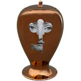Featuring a gray, keyhole-shaped illustration of a woman's face, the copper-tone Fornasetti Rame Vase ($1,219) is a cool, eclectic accent piece.