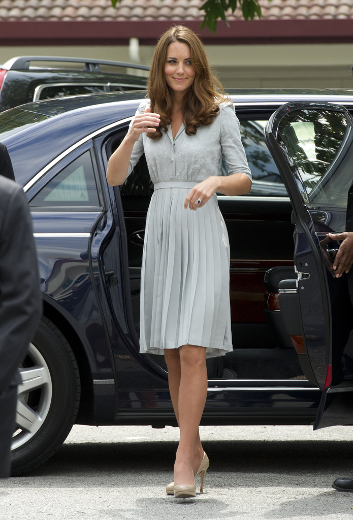 On arrival in Kuala Lumpur on Thursday Sept. 13, Kate donned bespoke duck-egg shirt-dress by Jenny Packham.