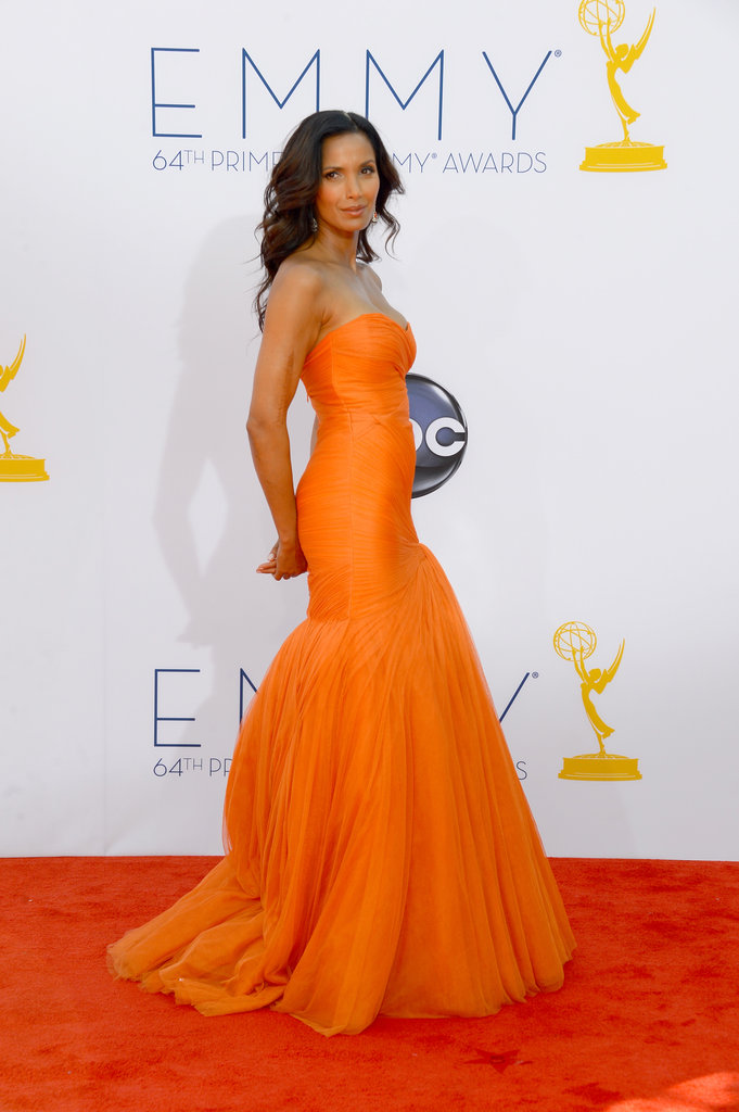 Top Chef host Padma Lakshmi rocked a bright orange dress on the red carpet.