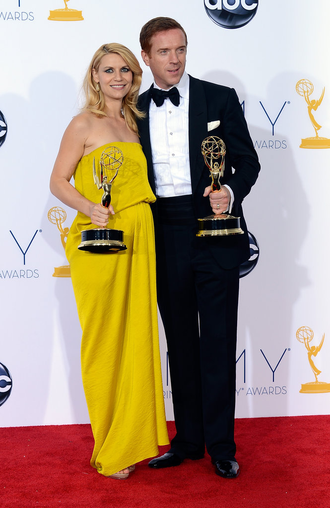 Homeland stars Claire Danes and Damian Lewis held up their Emmys.