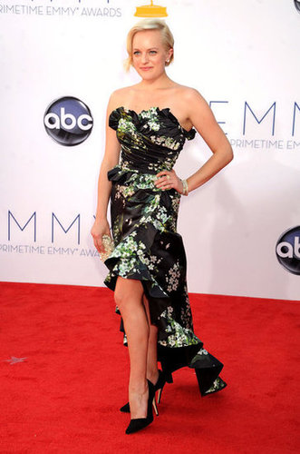 Elizabeth Moss showed off her legs under a floral gown on the red carpet.