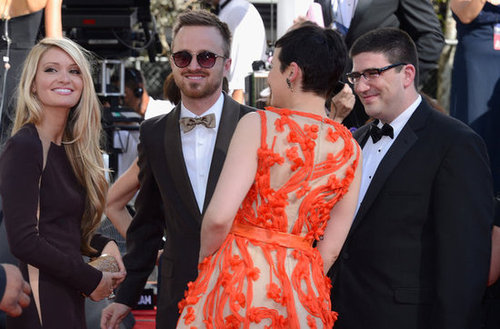 Ginnifer Goodwin greeted Aaron Paul and his fiancée Lauren Parsekian arriving at the Emmys.