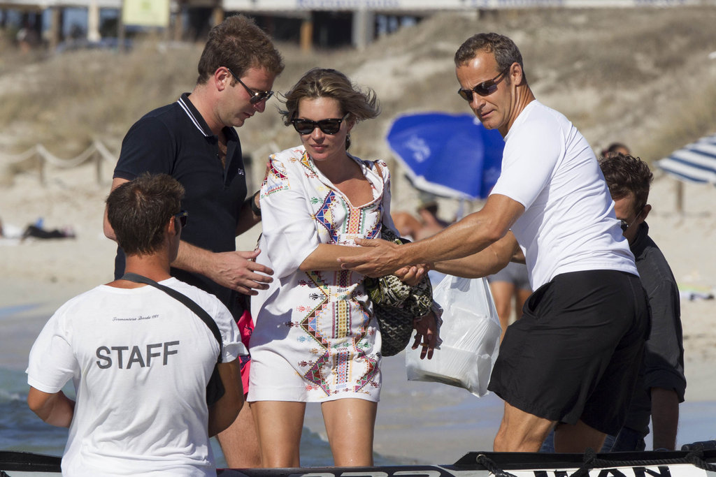 Kate Moss boarded a boat off of the beach in Ibiza.