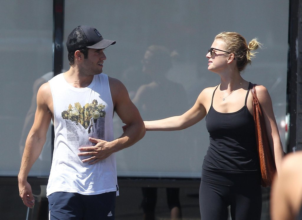 Emily VanCamp and Josh Bowman left the gym arm in arm.